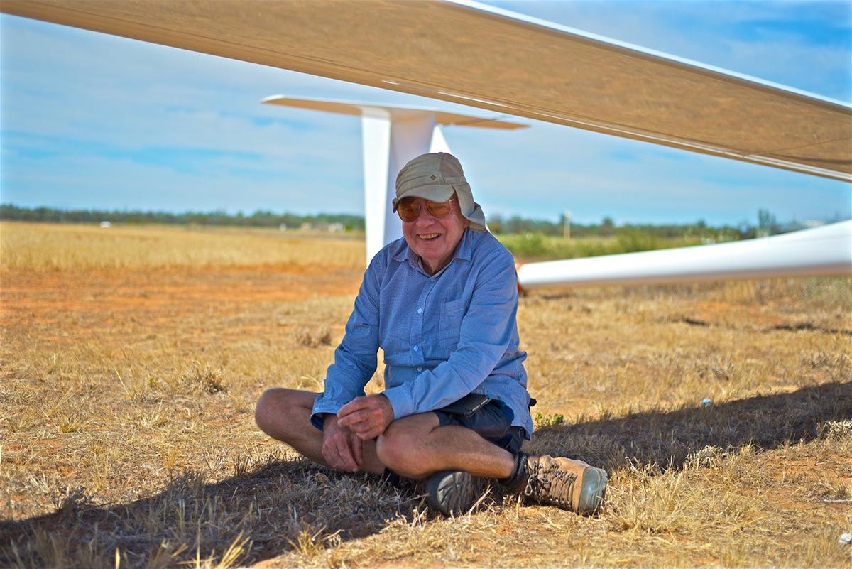 Geoff Sim under glider wing